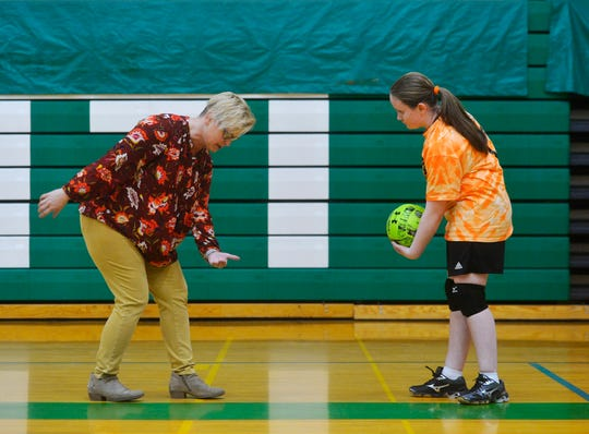 East Middle School 7th grader Davi Munroe works serving with her coach Jennifer Newman during volleyball practice, Thursday, Feb. 7, 2019.  Munroe, who is visually impaired, decided to try volleyball for the first time this year and has enjoyed her new sport and teammates.