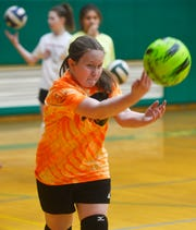 East Middle School 7th grader Davi Munroe practices her serve during volleyball practice, Thursday, Feb. 7, 2019.  Munroe, who is visually impaired, decided to try volleyball for the first time this year and has enjoyed her new sport and teammates.