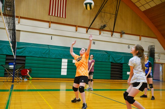 East Middle School 7th grader Davi Munroe scrimmages with her teammates during volleyball practice, Thursday, Feb. 7, 2019.  Munroe, who is visually impaired, decided to try volleyball for the first time this year and has enjoyed her new sport and teammates.