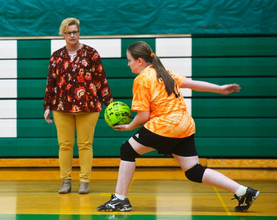 East Middle School 7th grader Davi Munroe makes a serve during volleyball practice, Thursday, Feb. 7, 2019.  Munroe, who is visually impaired, decided to try volleyball for the first time this year and has enjoyed her new sport and teammates.