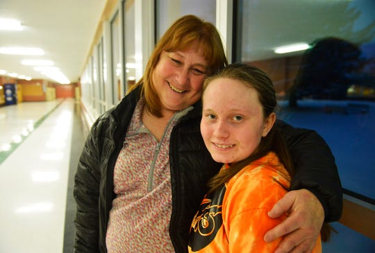 East Middle School 7th grader Davi Munroe with her mother Lori Armstrong after volleyball practice, Thursday, Feb. 7, 2019.  Munroe, who is visually impaired, decided to try volleyball for the first time this year and has enjoyed her new sport and teammates.