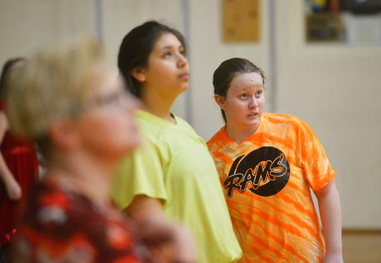 East Middle School 7th grader Davi Munroe, who is visually impaired, is trying volleyball for the first time and says that it is difficult but she enjoys it.