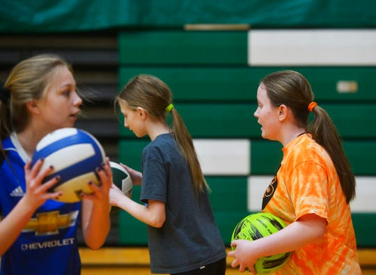 East Middle School 7th grader Davi Munroe goes through drills with her teammates during volleyball practice, Thursday, Feb. 7, 2019.  Munroe, who is visually impaired, decided to try volleyball for the first time this year and has enjoyed her new sport and teammates.