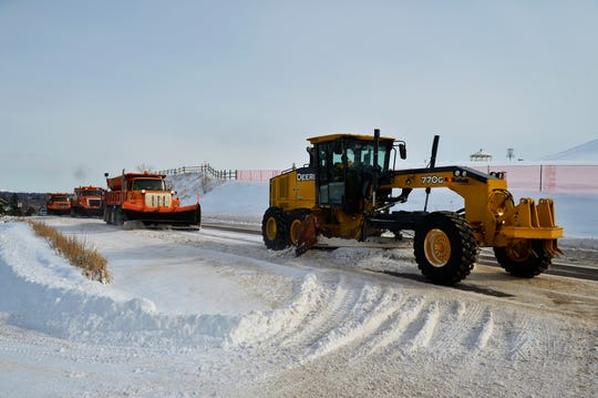 A city plow crew clears some of the hardpack snow from Overlook Drive on Tuesday morning, February 12.  A slight warming trend is expected in Great Falls with the National Weather Service forecast calling for temperatures in the low double digits by the end of the week ending a week-long stretch of mostly sub-zero temperatures.