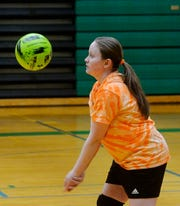 East Middle School 7th grader Davi Munroe makes a pass during volleyball practice, Thursday, Feb. 7, 2019.  Munroe, who is visually impaired, decided to try volleyball for the first time this year and has enjoyed her new sport and teammates.