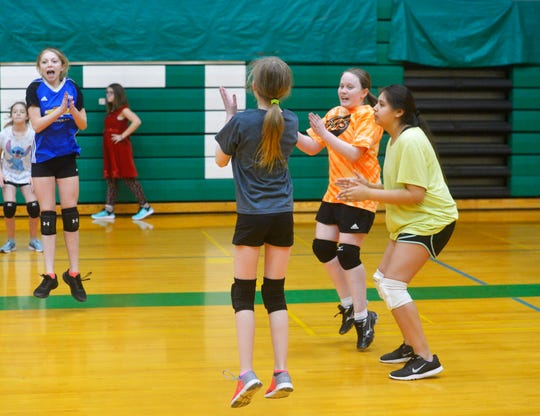 East Middle School 7th grader Davi Munroe celebrates winning a point during volleyball practice, Thursday, Feb. 7, 2019.  Munroe, who is visually impaired, decided to try volleyball for the first time this year and has enjoyed her new sport and teammates.