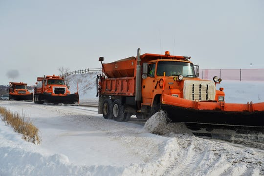 A city plow crew clears snow from Overlook Drive Tuesday. Another inch of snow is possible in the city Wednesday.