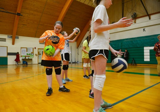 East Middle School 7th grader Davi Munroe lines up for a drill with her teammates during volleyball practice, Thursday, Feb. 7, 2019.  Munroe, who is visually impaired, decided to try volleyball for the first time this year and has enjoyed her new sport and teammates.