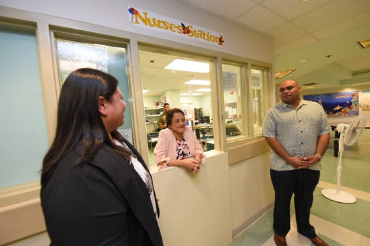 Gov. Lou Leon Guerrero, center, Carissa Pangelinan, deputy director of the Guam Behavioral Health and Wellness Center, and Lt. Gov. Josh Tenorio, at the facility's nurses station in this Feb. 12 file photo.