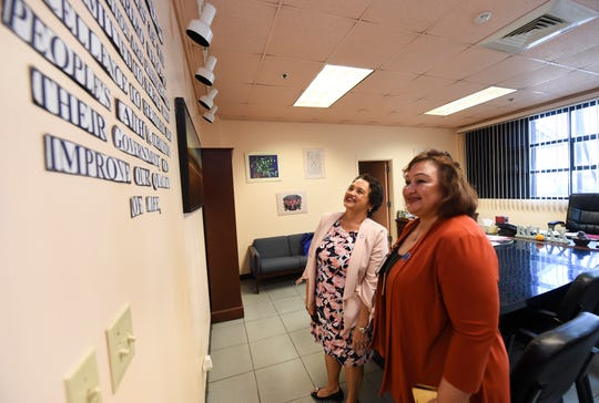 Gov. Lou Leon Guerrero , left, is guided through a facility tour by Therese Arriola, Guam Behavioral Health and Wellness Center director, in Tamuning on Feb. 12, 2019.