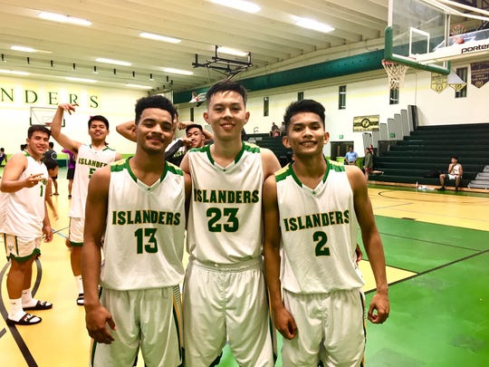 Junior point guard Jerry Ngiraremiang, No. 13, kept the Islanders under control and always in the lead, while senior teammates No. 23 Chris Morikami and No. 2 Karl De Mesa, combined for 31 points in JFK's 51-37 victory over the Guam High Panthers on Feb. 12 at JFK. The Islanders improved to 9-1 in IIAAG High School Boys Basketball.