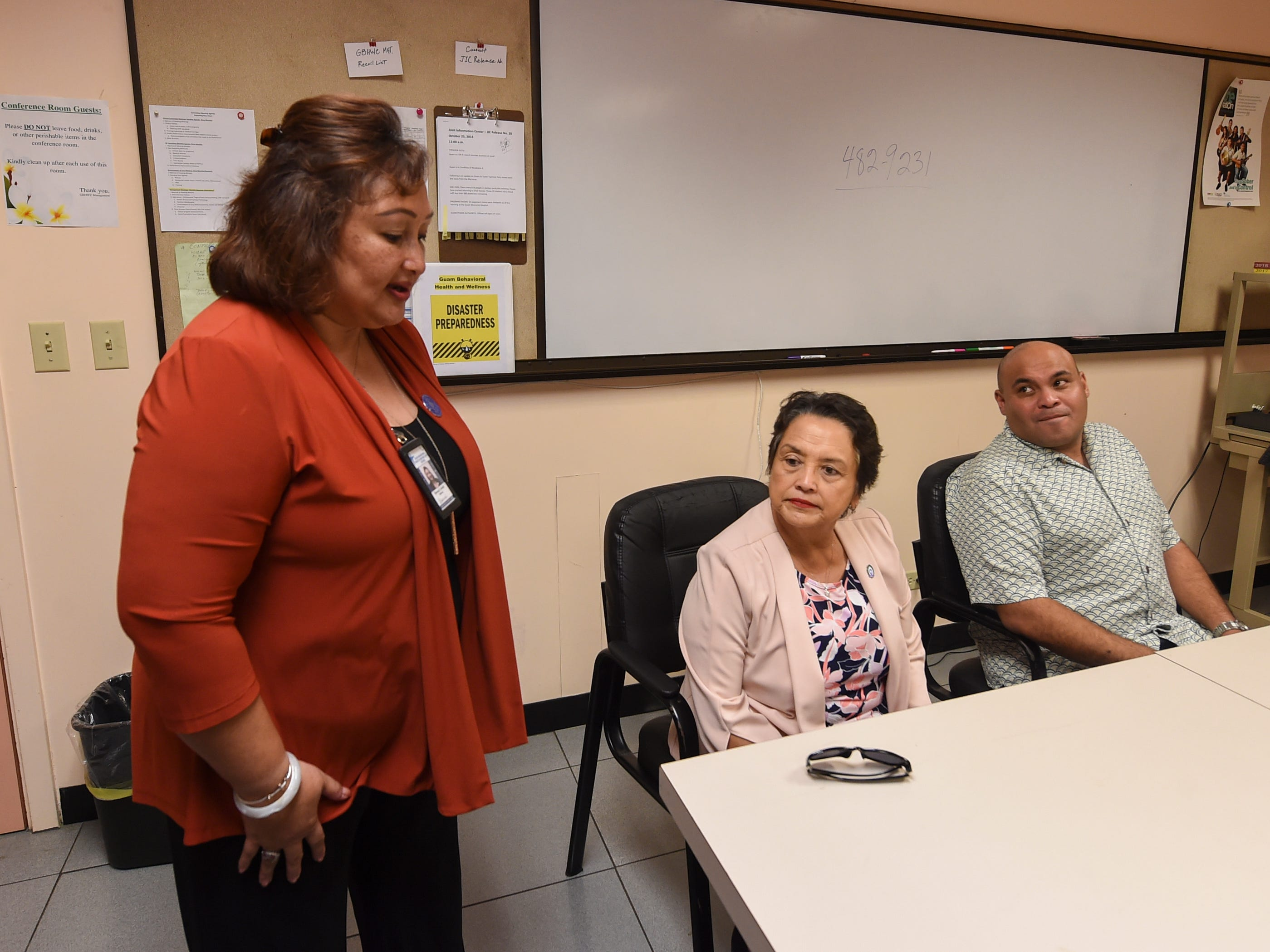 Therese Arriola, left, the director of the Guam Behavioral Health and Wellness Center, speaks during a meeting with Gov. Lou Leon Guerrero and Lt. Gov Josh Tenorio at their facility's conference room in Tamuning on Feb. 12, 2019.