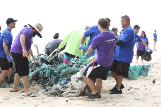 Bank of Hawaii hosts a beach clean-up day.