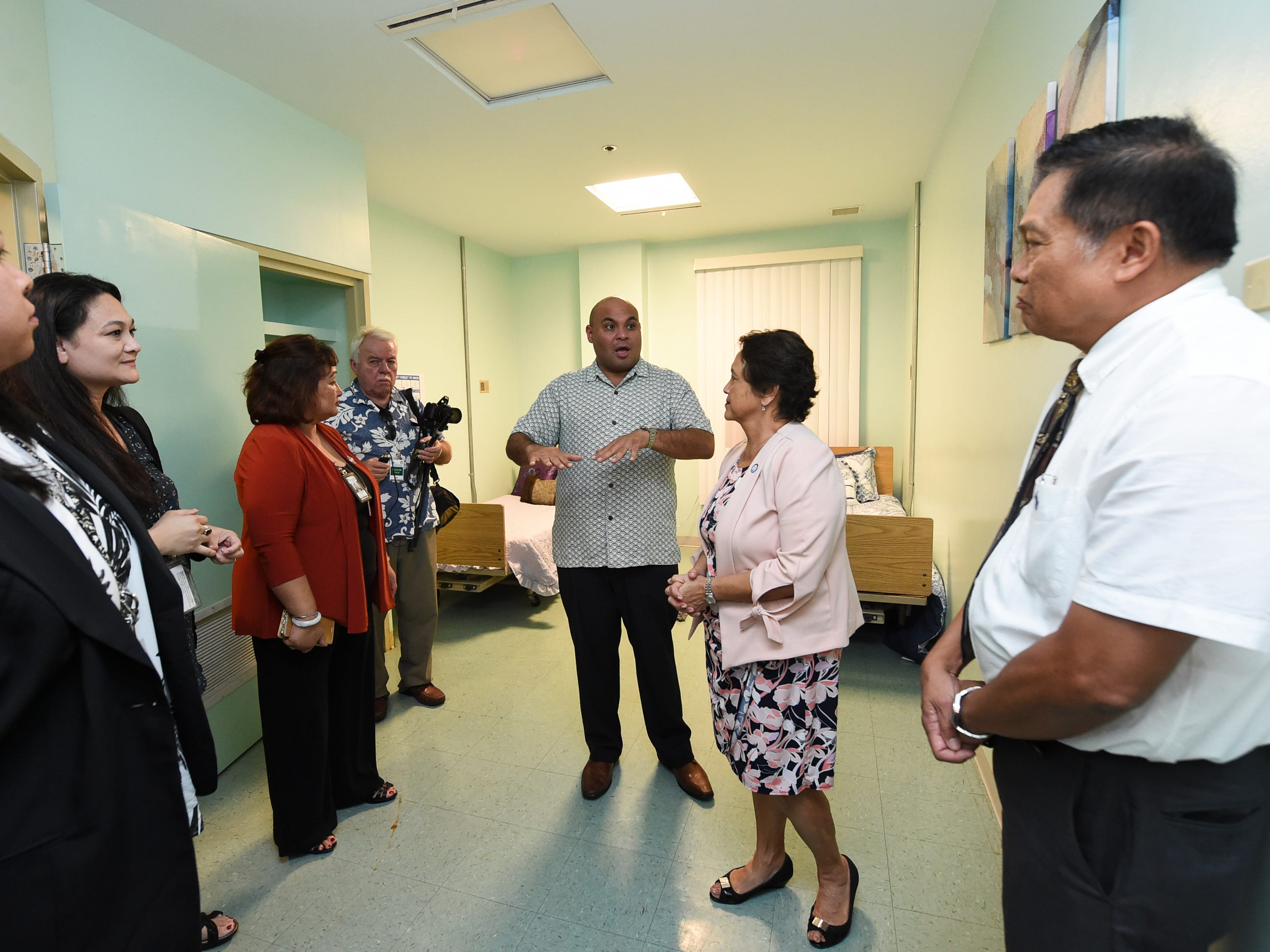 Gov. Lou Leon Guerrero and Lt. Gov. Josh Tenorio are given a tour of a patient room at the Guam Behavioral Health and Wellness Center in Tamuning on Feb. 12, 2019.
