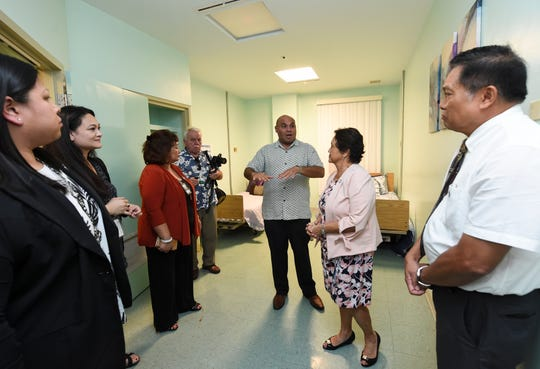 Gov. Lou Leon Guerrero and Lt. Gov. Josh Tenorio are given a tour of a patient room at the Guam Behavioral Health and Wellness Center in Tamuning in this Feb. 12, 2019, file photo.