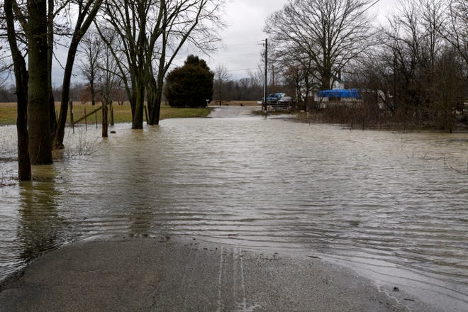 Water covers part of West Pikes Landing Road, located near KY-811, in Reed, Ky., Tuesday, Feb. 12, 2019. As of early Tuesday afternoon, the Ohio River at Evansville was measured to be 41 feet, one foot below flood stage. The current forecast calls for the river to crest on Sunday at close to 44 feet.