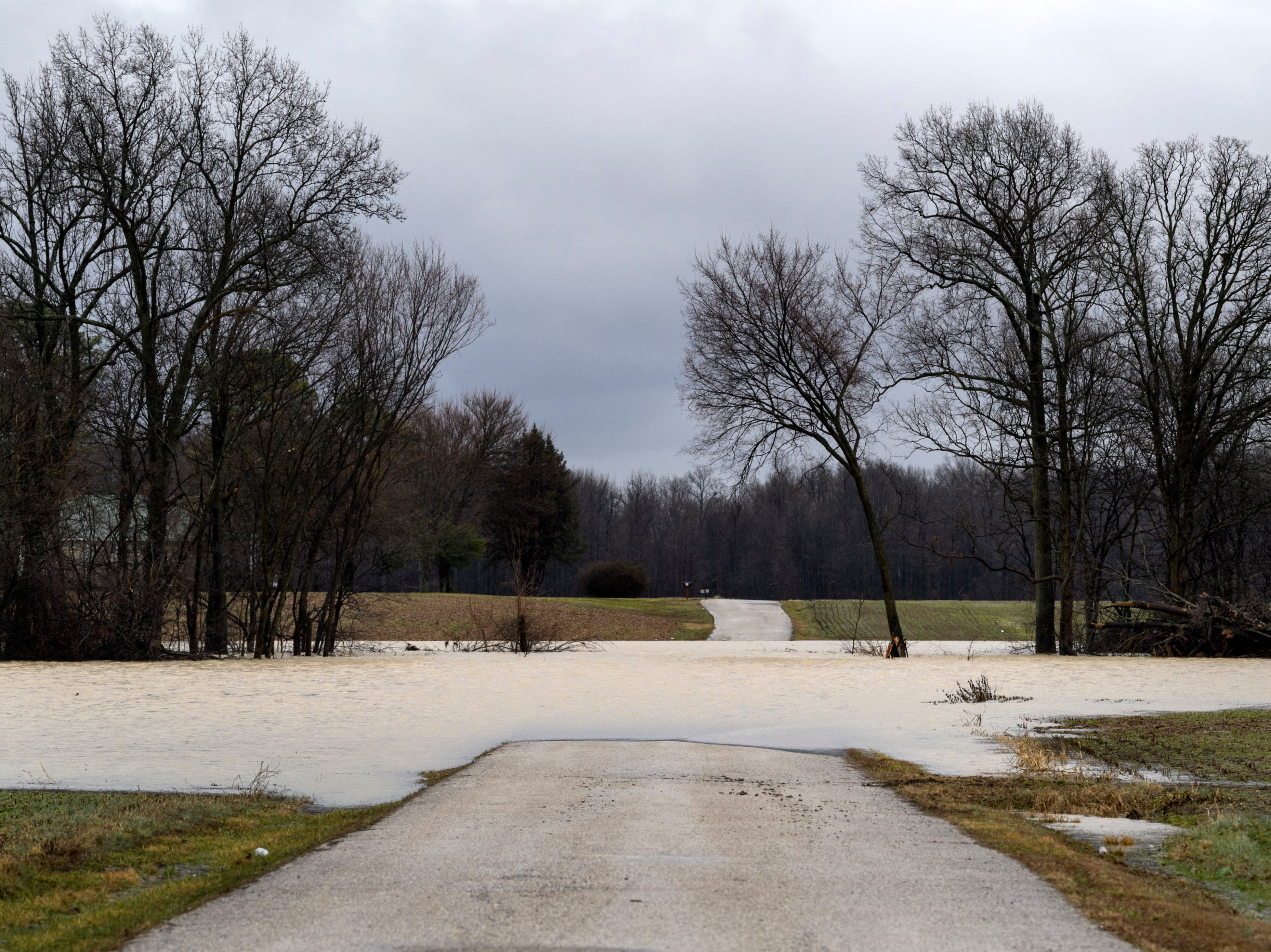 Water covers a section of East Pikes Landing Road near KY-811 in Reed, Ky., Tuesday, Feb. 12, 2019. As of early Tuesday afternoon, the Ohio River at Evansville was measured to be 41 feet, one foot below flood stage, and the current forecast calls for the river to crest on Sunday at close to 44 feet.