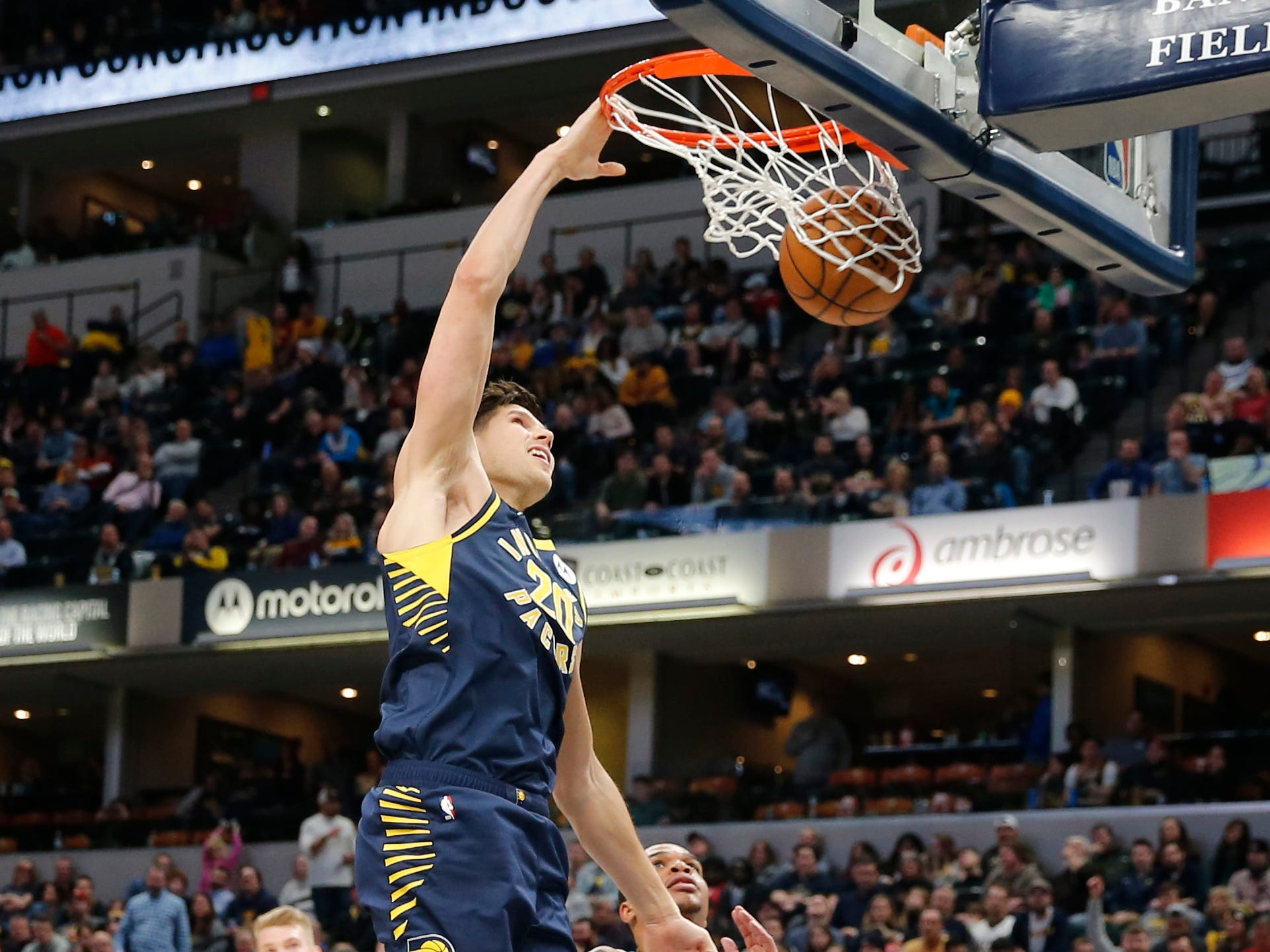 Feb 11, 2019; Indianapolis, IN, USA; Indiana Pacers forward Doug McDermott (20) dunks against Charlotte Hornets forward Miles Bridges (0) during the fourth quarter at Bankers Life Fieldhouse.