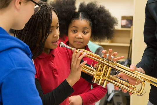 Students from Sycamore School and the Wheeler-Dowe Boys & Girls Club explored musical instruments together on Feb. 11, 2019. The event was a celebration of a newly renovated classroom, part of a project by Sycamore Serves and the club.