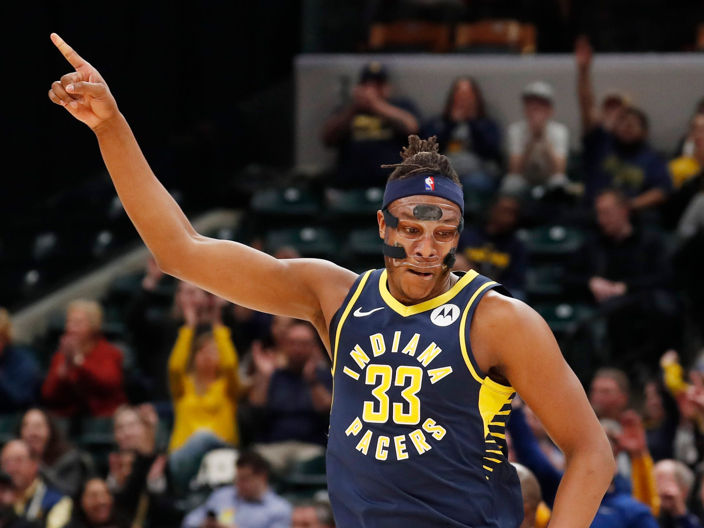 Feb 11, 2019; Indianapolis, IN, USA; Indiana Pacers center Myles Turner (33) reacts to making a three point shot against the Charlotte Hornets during the first quarter at Bankers Life Fieldhouse.
