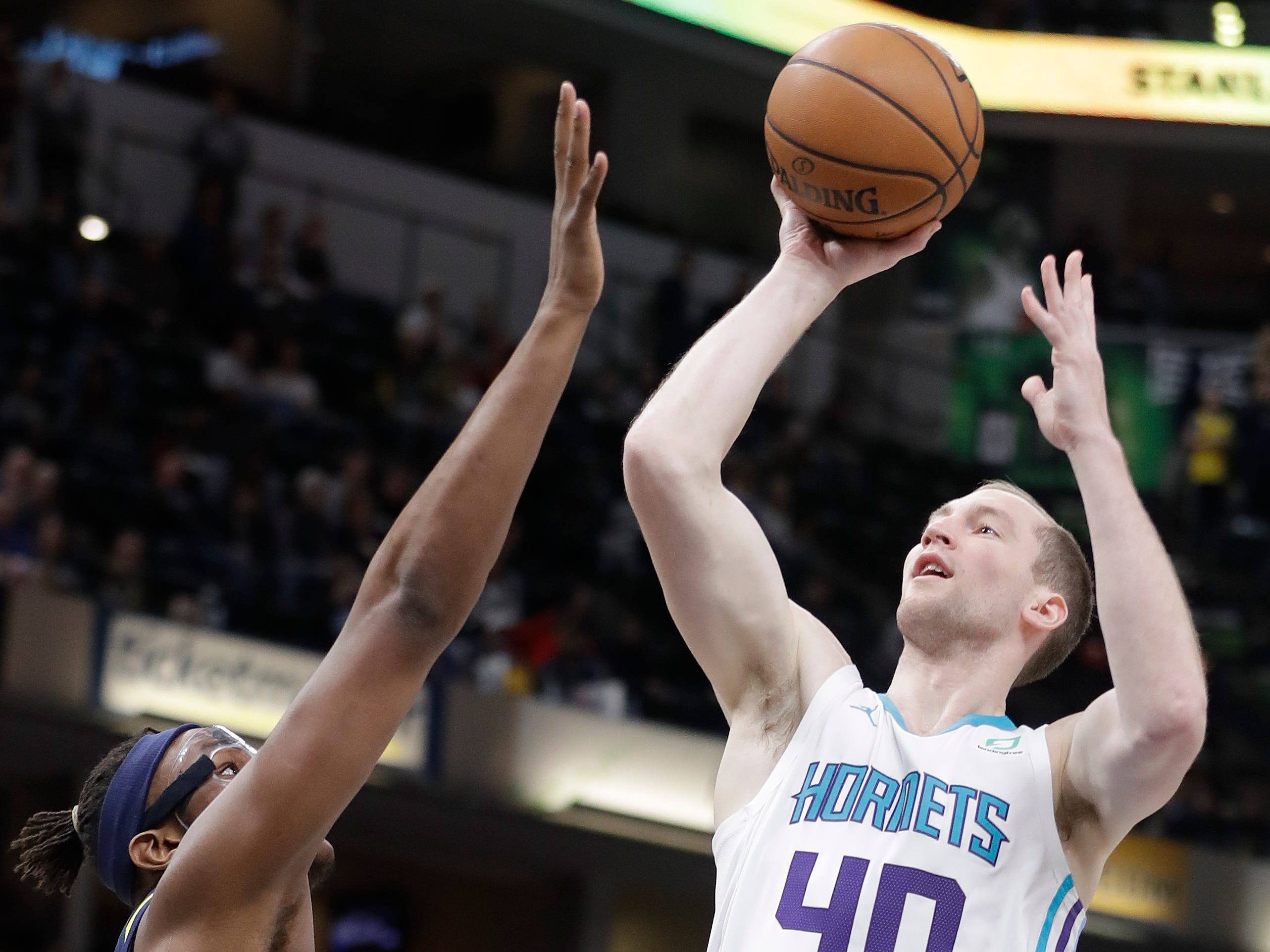 Charlotte Hornets' Cody Zeller (40) shoots over Indiana Pacers' Myles Turner during the first half of an NBA basketball game, Monday, Feb. 11, 2019, in Indianapolis.