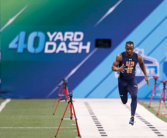 Mar 4, 2017; Indianapolis, IN, USA; Washington Huskies wide receiver John Ross runs the 40 yard dash during the 2017 NFL Combine at Lucas Oil Stadium.