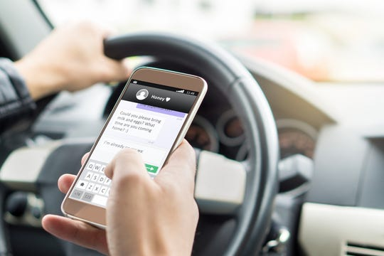 Indiana Gov. Eric Holcomb has called for a ban on use of hand-held cellphones while driving.