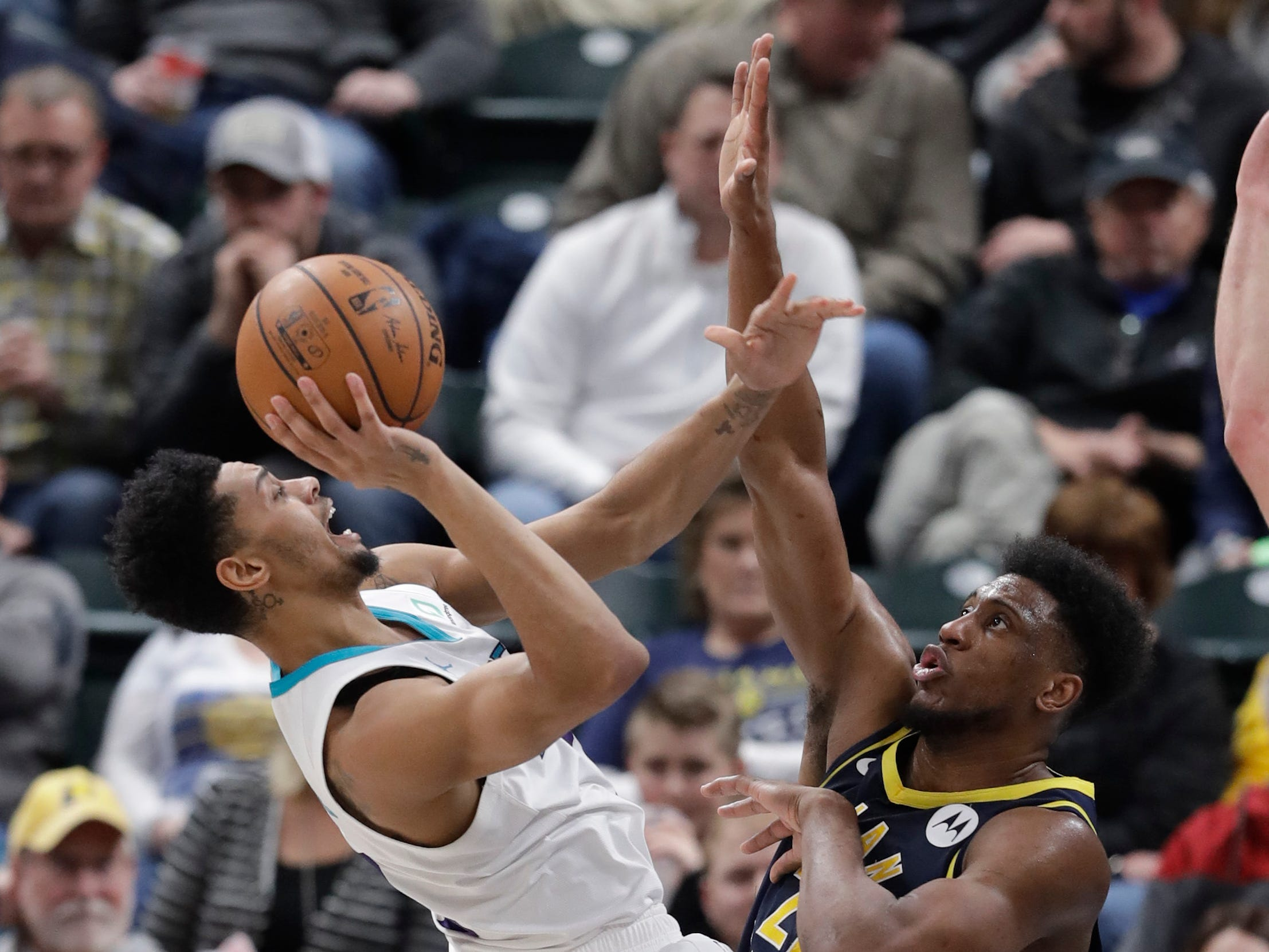 Charlotte Hornets' Jeremy Lamb (3) puts up a shot against Indiana Pacers' Thaddeus Young (21)[ during the second half of an NBA basketball game, Monday, Feb. 11, 2019, in Indianapolis. Indiana won 99-90.