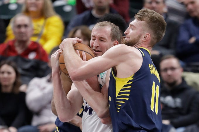 Charlotte Hornets' Cody Zeller (40) and Indiana Pacers' Domantas Sabonis (11) battle for a rebound during the second half of an NBA basketball game, Monday, Feb. 11, 2019, in Indianapolis. Indiana won 99-90.