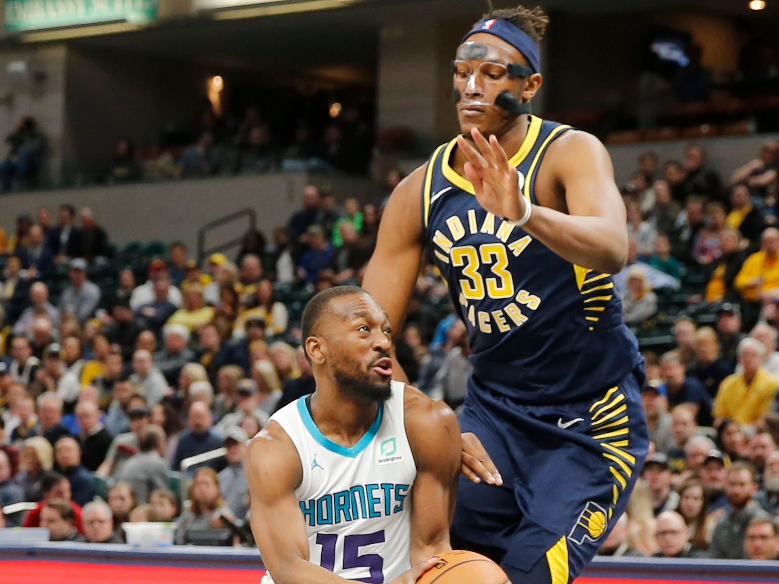 Feb 11, 2019; Indianapolis, IN, USA; Charlotte Hornets guard Kemba Walker (15) drives to the basket against Indiana Pacers center Myles Turner (33) during the first quarter at Bankers Life Fieldhouse.