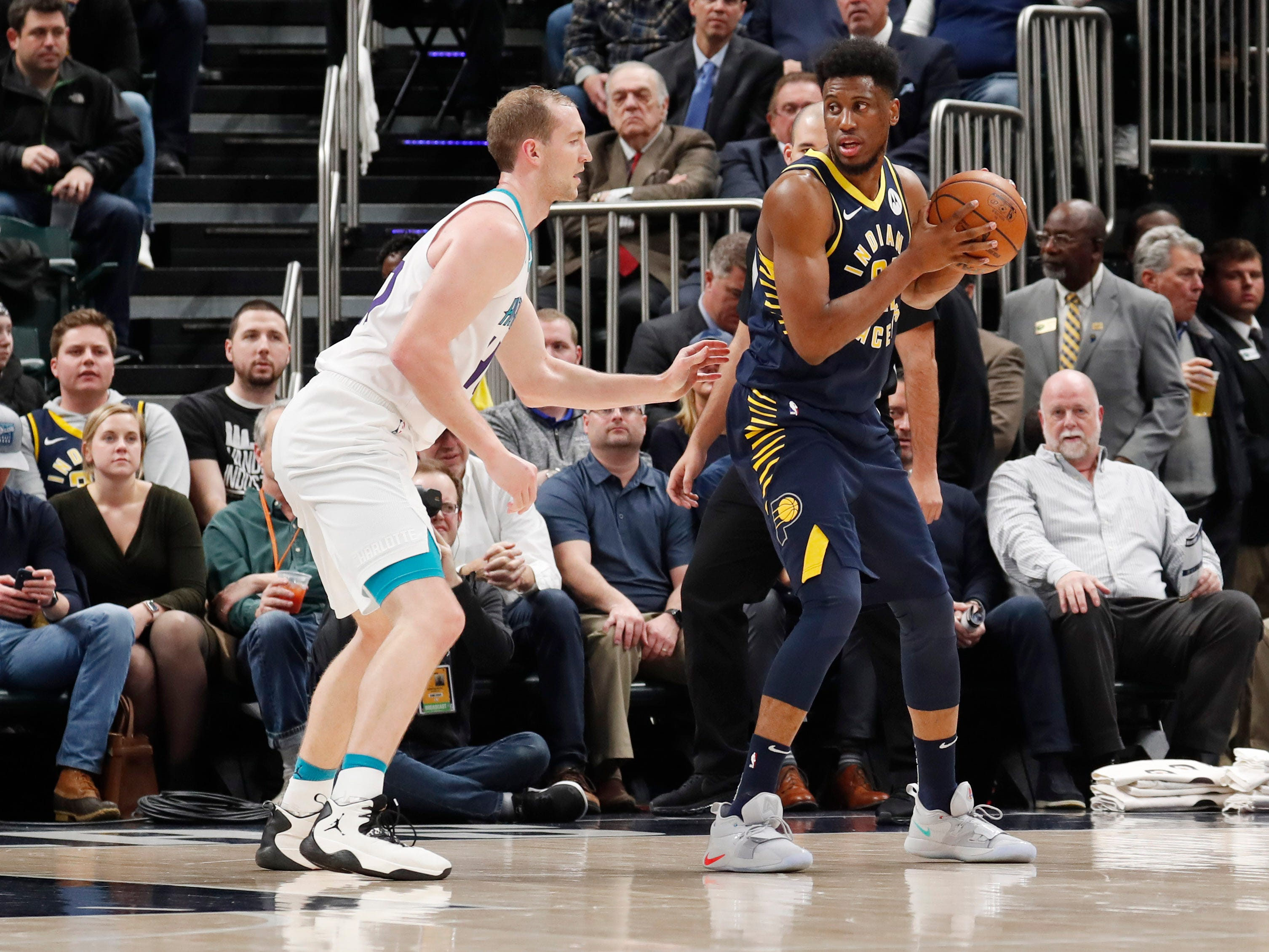 Feb 11, 2019; Indianapolis, IN, USA; Indiana Pacers forward Thaddeus Young (21) is guarded by Charlotte Hornets center Cody Zeller (40) during the first quarter at Bankers Life Fieldhouse.