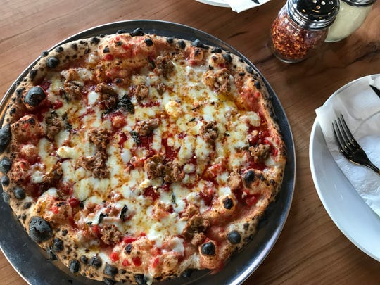 Rosemary, basil, garlic, sausage, goat cheese, aged mozzarella, red sauce and a drizzle of hot honey top the Destroyer at King Dough. The pizzeria opened in January 2019 in the Holy Cross area of Indianapolis.