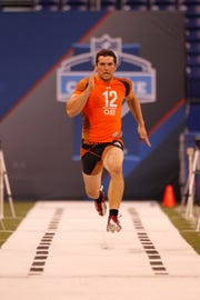 Stanford quarterback Andrew Luck warms up at the NFL football scouting combine in Indianapolis on Sunday, Feb. 26, 2012.