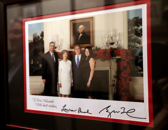 This is a photo presented to Eric Holcomb and signed by President George Bush and First Lady Laura Bush, seen at the Governor's residence, Monday, Feb. 11, 2019.  Governor Eric Holcomb has a collection of presidential signatures and other historic documents in the personal residence of the Governor's Mansion.  Collecting such items are a hobby of the history buff.