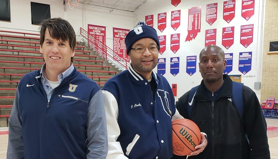 From left, University girls basketball  volunteer...