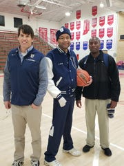 From left, University girls basketball  volunteer assistant John Fair; Dr. Chris Cosby; University coach Justin Blanding after the Blazers beat Greenwood Christian to advance to semi state.