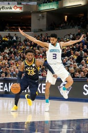 Feb 11, 2019; Indianapolis, IN, USA; Indiana Pacers guard Wesley Matthews (23) drives to the basket against Charlotte Hornets guard Jeremy Lamb (3) during the third quarter at Bankers Life Fieldhouse.