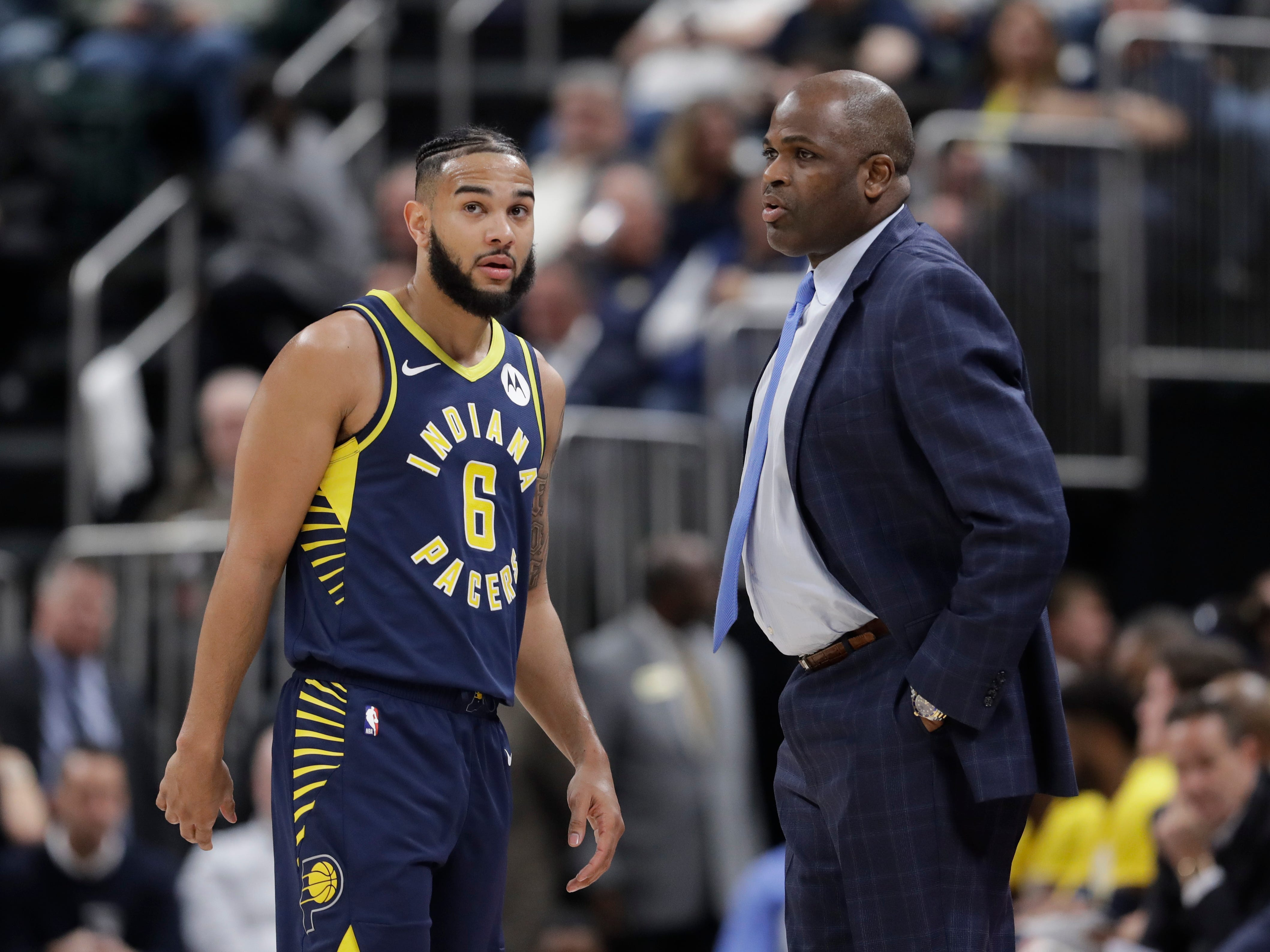 Indiana Pacers head coach Nate McMillan, right, talks with Cory Joseph during the first half of an NBA basketball game against the Charlotte Hornets, Monday, Feb. 11, 2019, in Indianapolis.