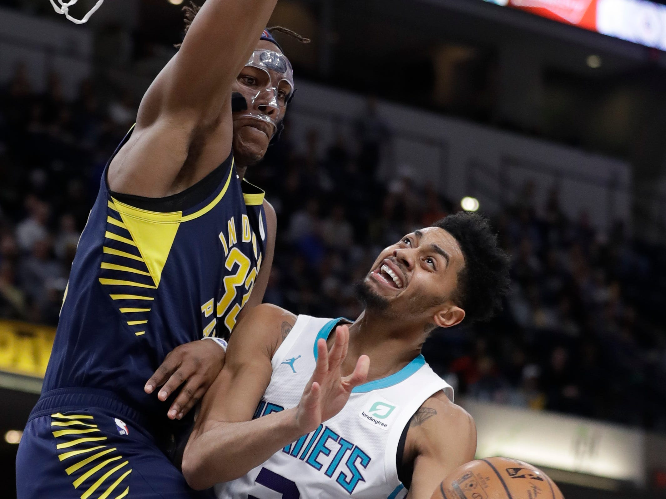Charlotte Hornets' Jeremy Lamb (3) puts up a shot against Indiana Pacers' Myles Turner during the first half of an NBA basketball game, Monday, Feb. 11, 2019, in Indianapolis. (AP Photo/Darron Cummings)