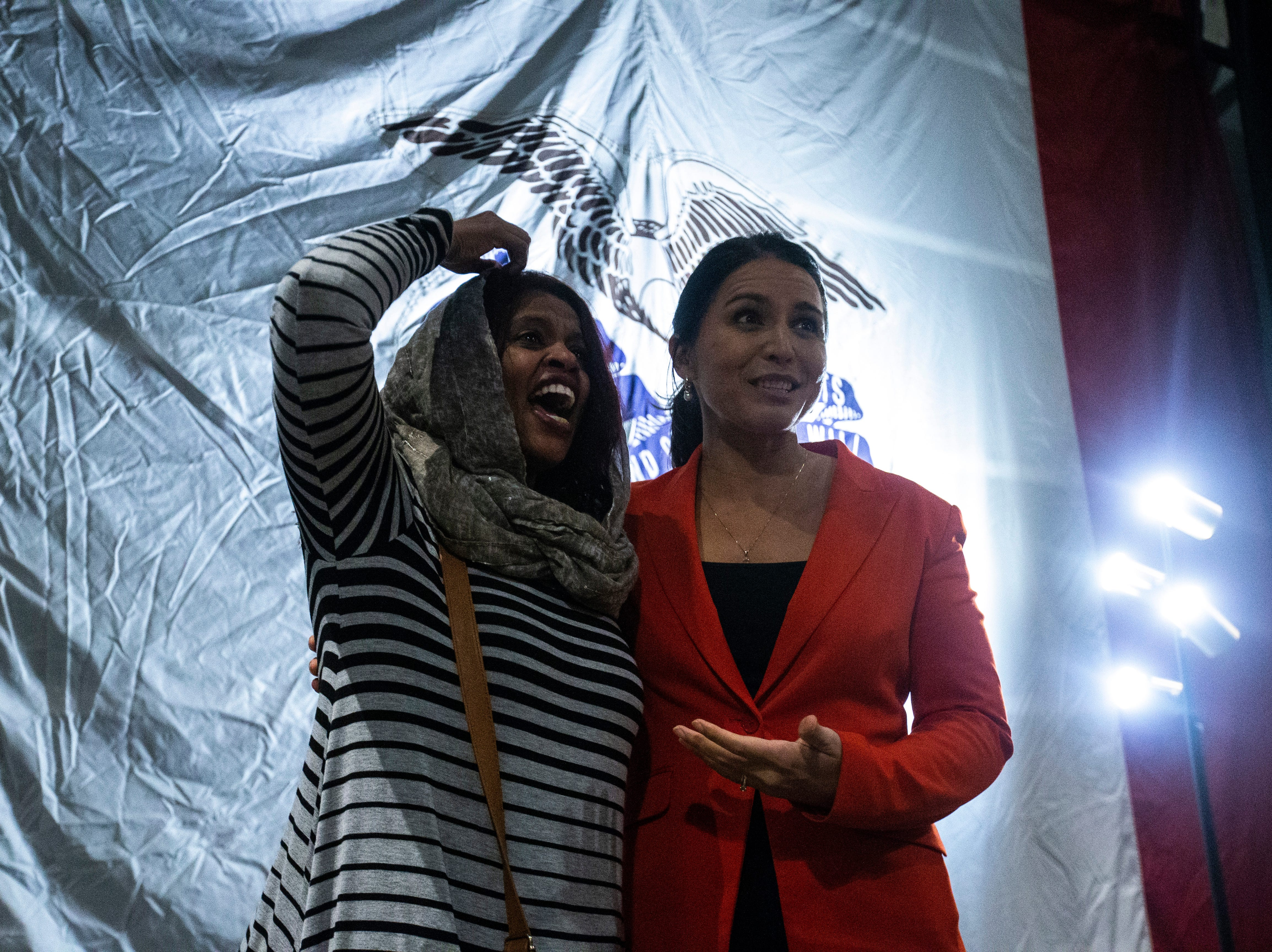 U.S. Rep. Tulsi Gabbard, D-Hawaii, takes a photo with Iowa City Councilor Mazahir Salih during an event on Gabbard's first trip to Iowa since declaring her intent to run for president on Monday, Feb. 11, 2019 at Big Grove Brewery in Iowa City.