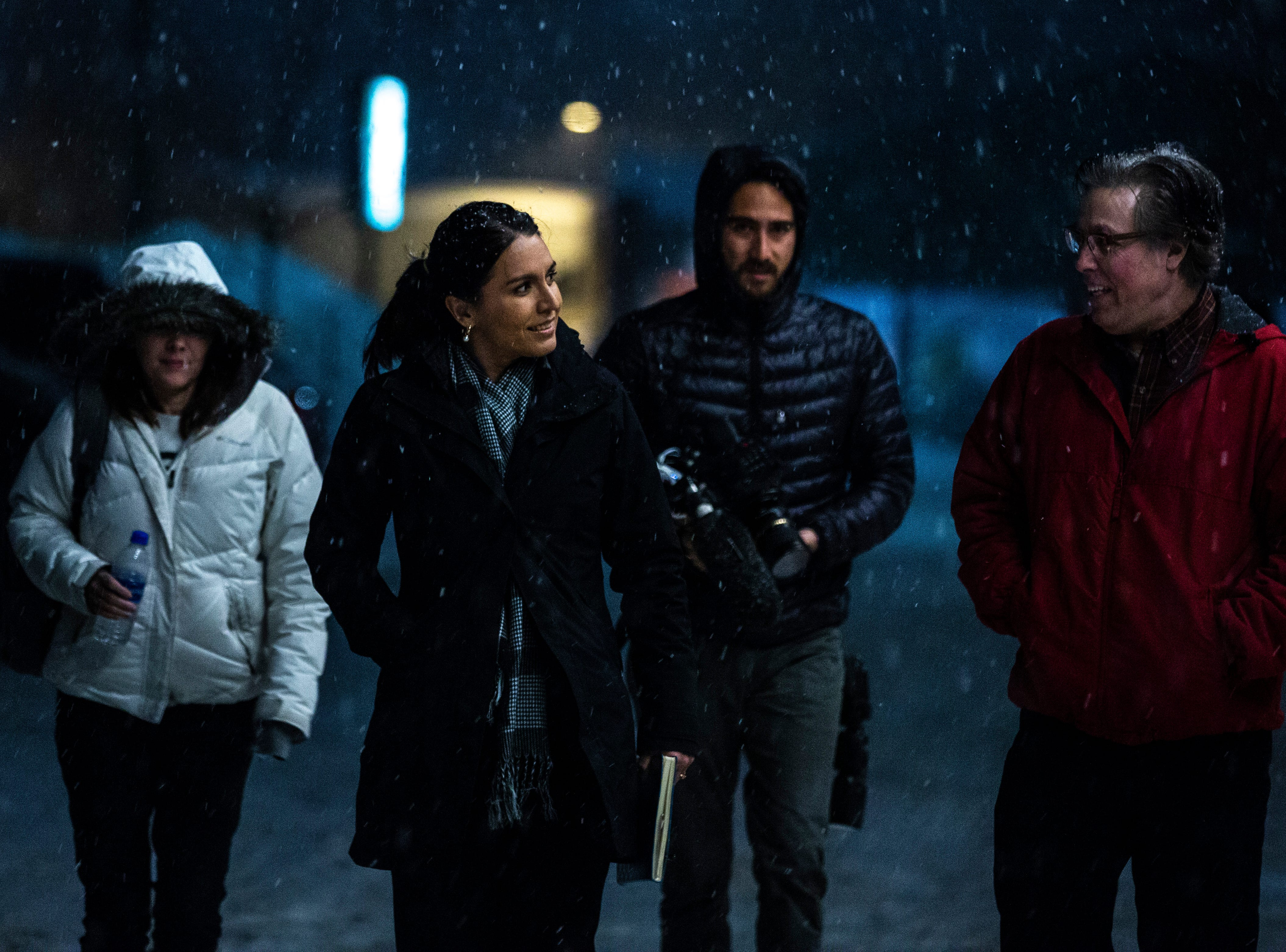 U.S. Rep. Tulsi Gabbard, D-Hawaii, arrives in the snow for an event on her first trip to Iowa since declaring her intent to run for president on Monday, Feb. 11, 2019 at Big Grove Brewery in Iowa City.