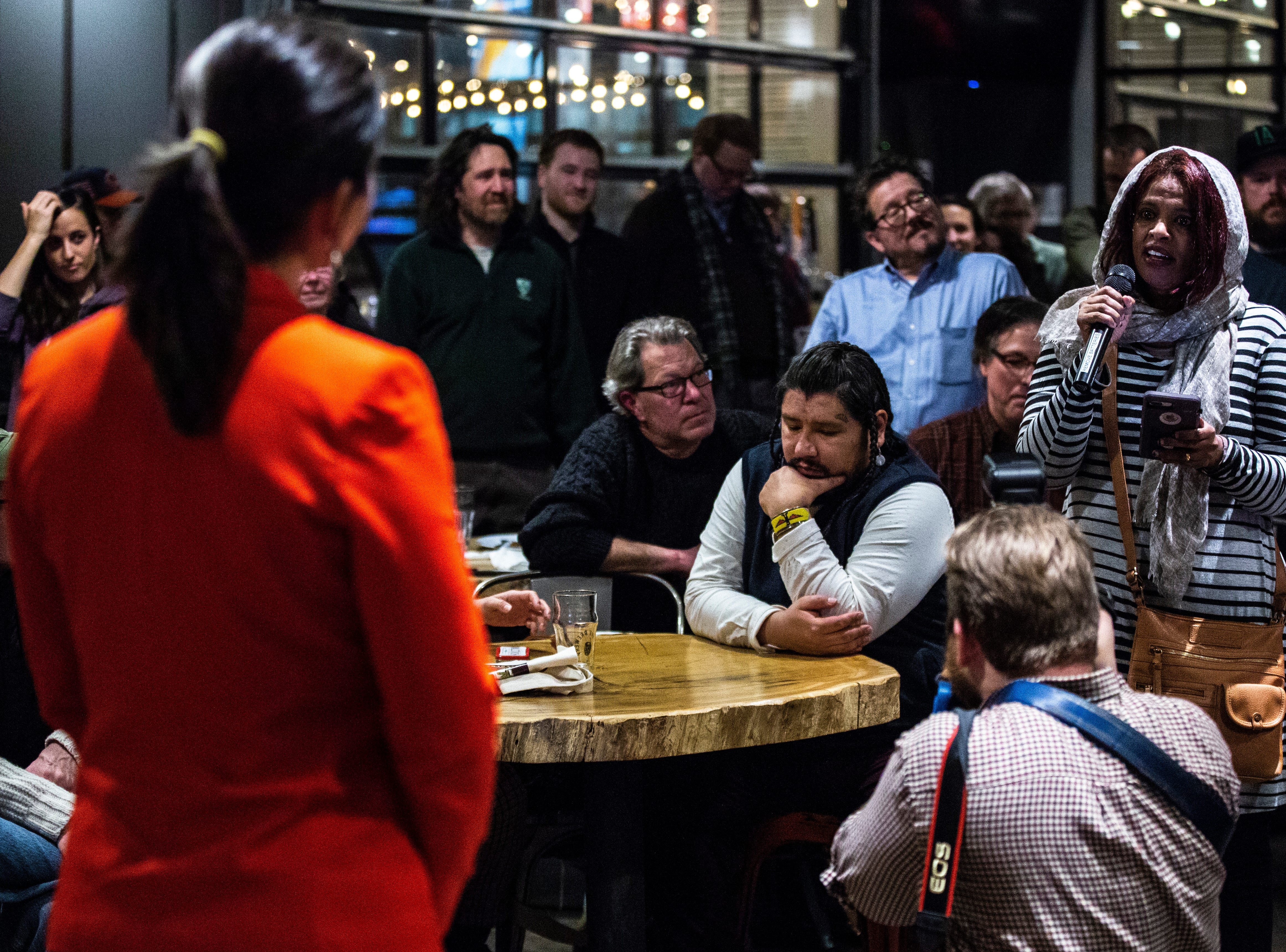 U.S. Rep. Tulsi Gabbard, D-Hawaii, listens to a question from Iowa City Councilor Mazahir Salih during an event on Gabbard's first trip to Iowa since declaring her intent to run for president on Monday, Feb. 11, 2019 at Big Grove Brewery in Iowa City.