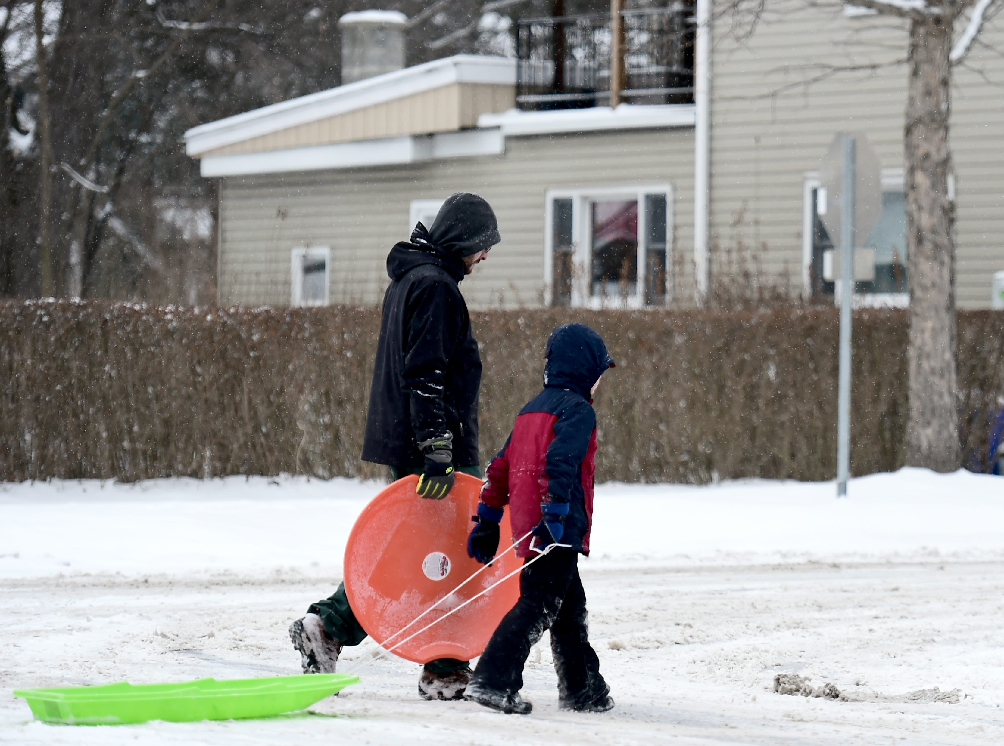 Jonathan and Gavin Peet took advantage of the day off from school by sledding in the Fall Creek area of Ithaca on Tuesday, February 12, 2019.