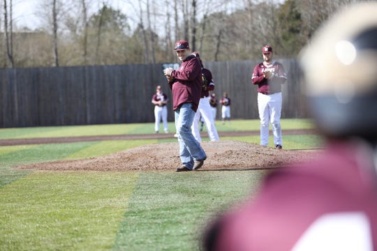 Slater Springman pitches from the stretch before FHU's home opener on Friday afternoon.