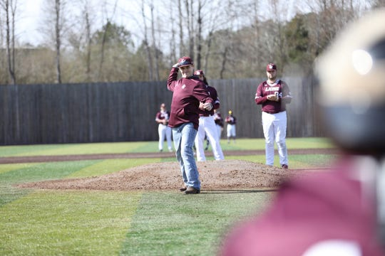 Slater Springman throws out the opening pitch before the FHU baseball home opener Friday. Springman collapsed after a heat stroke and spent more than two months in the hospital rehabbing. He hopes to be back on campus and on the baseball team as soon as this fall.