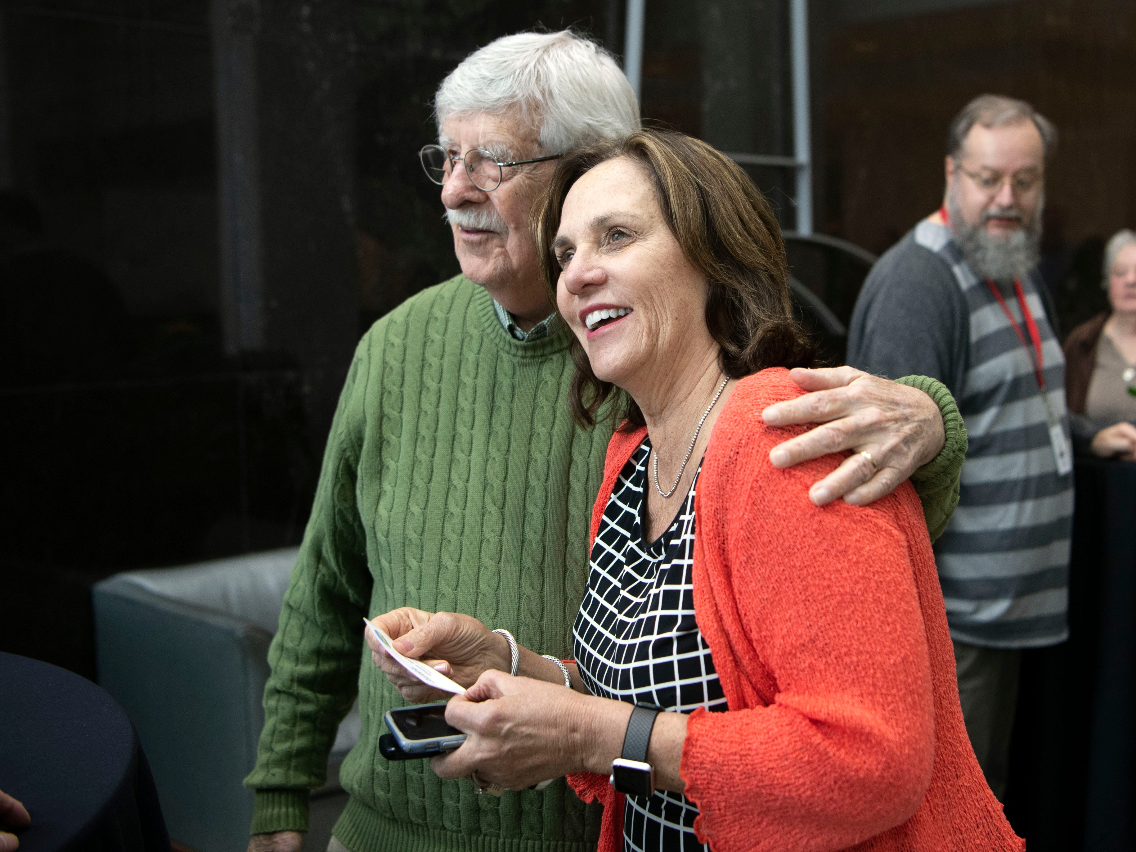 Elaine Streno, executive direction at Second Harvest Food Bank of East Tennessee greets longtime News Sentinel cartoonist Charlie Daniel on Monday, February 11, 2019 during a party recognizing Daniel, outgoing editor Jack McElory