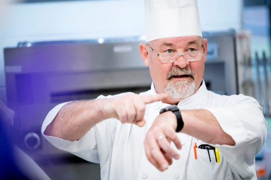 Culinary Arts Program Director Chef Greg Eisele points to his watch to keep the class on track during a cooking class at Tennessee School for the Deaf Knoxville, in Knoxville, Tennessee on Tuesday, February 12, 2019. Students enrolled in STEP were taking a culinary class through the UT Culinary and Catering Program.