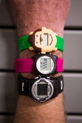 Founder and CEO of PottyMD, Dr. Preston Smith wears the Potty Monkey Watch, the WobL+ Watch and WobL watch at PottyMD in West Knoxville Tuesday, Feb. 12, 2019. The local company manufactures watches to help potty train children and other members of the population.