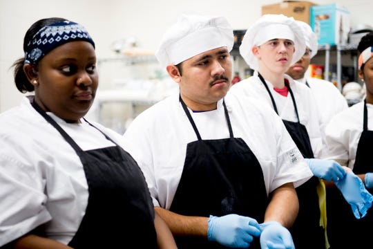Carlos Mejia pays attention to instruction during a cooking class at Tennessee School for the Deaf Knoxville, in Knoxville, Tennessee on Tuesday, February 12, 2019. Students enrolled in STEP were taking a culinary class through the UT Culinary and Catering Program.