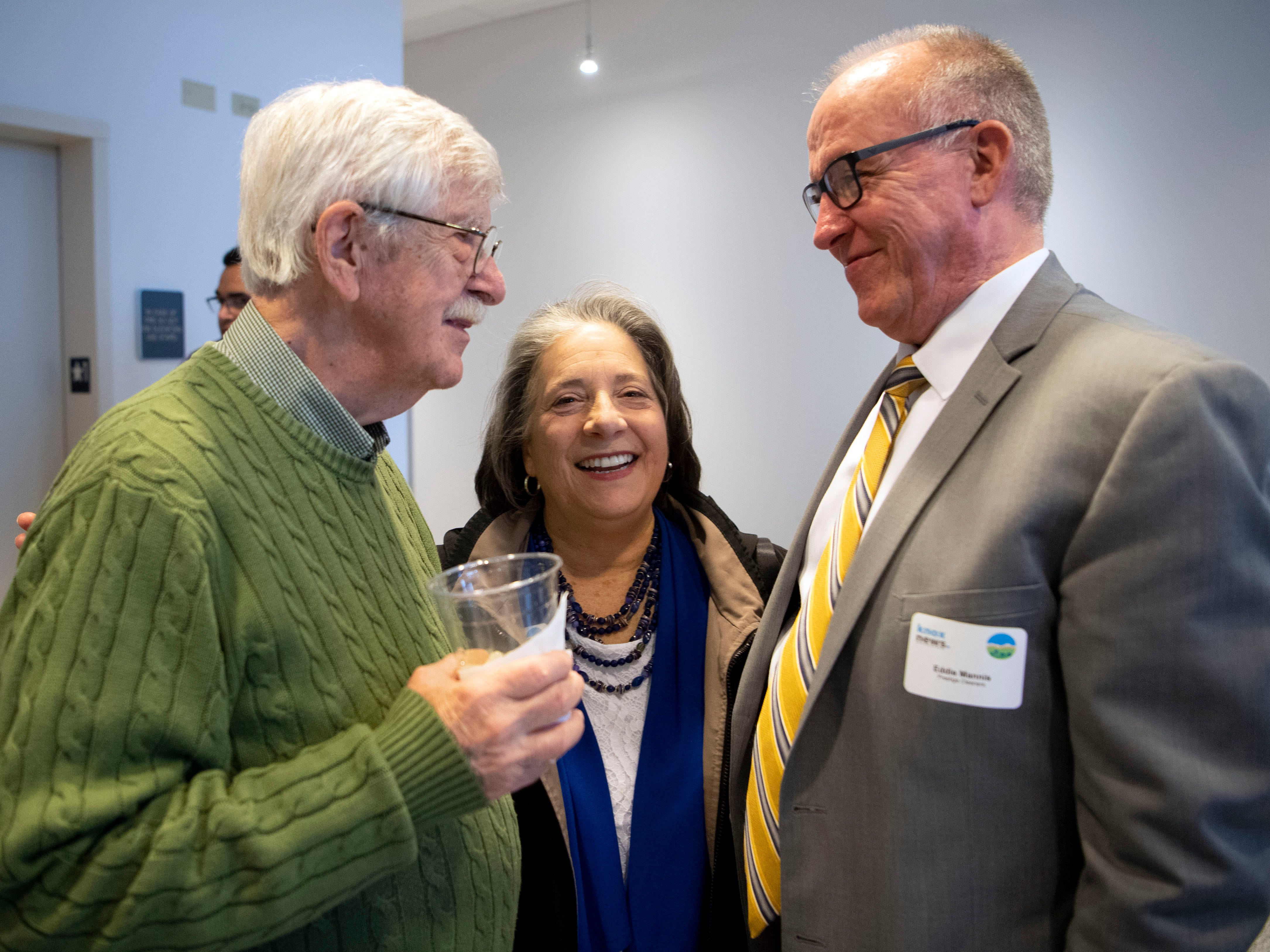 Recently retired News Sentinel cartoonist Charlie Daniel chats with Mayor Madeline Rogero and Metropolitan Airport Authority Chairman Eddie Mannis during a reception recognizing Daniel and outgoing executive editor Jack McElroy but also to welcome new executive editor Joel Christopher on Monday, February 11, 2019.
